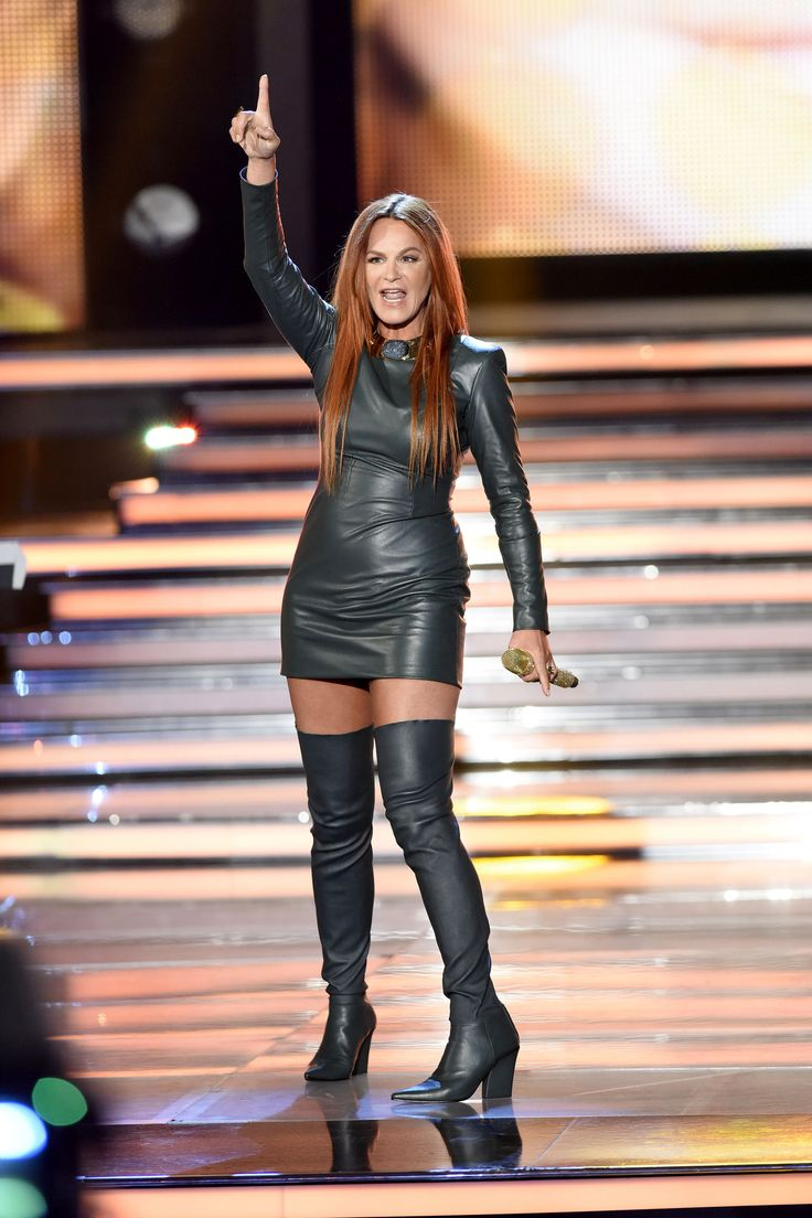 Andrea Berg long sleeve leather minidress and matching thigh boots onstage