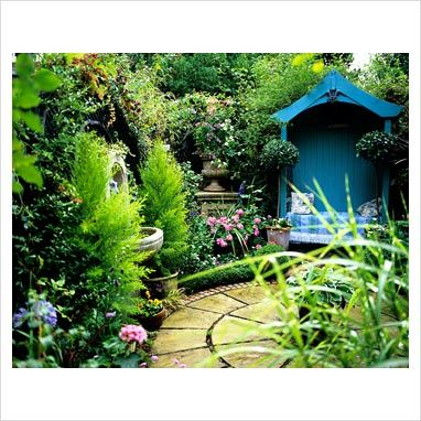 Painted blue arbour in small courtyard garden