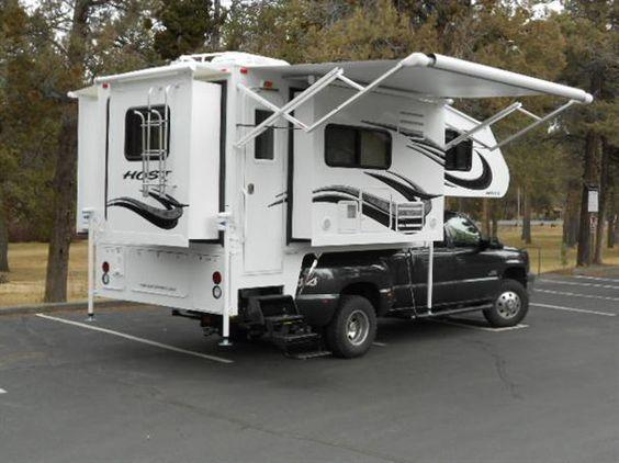 Mammoth camper by Host (11.5'), fireplace, walk-thru dry bath, two TVs, etc.