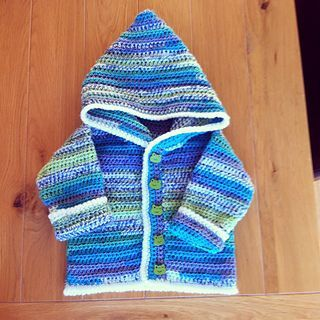 Sweet Baby Hoodie. Do this in Cream for a Yoda Sweater. Got this idea from Susie Sauceda.  Then make a yoda hat and a Lightsaber from a free pattern on Revelry by Michael Snow. Then make dark brown booties from a free pattern on repeatcrafterme.com (Cuffed Baby Booties) For the sweater, do a crochet chain for a belt. (No buttons.). Stunning!