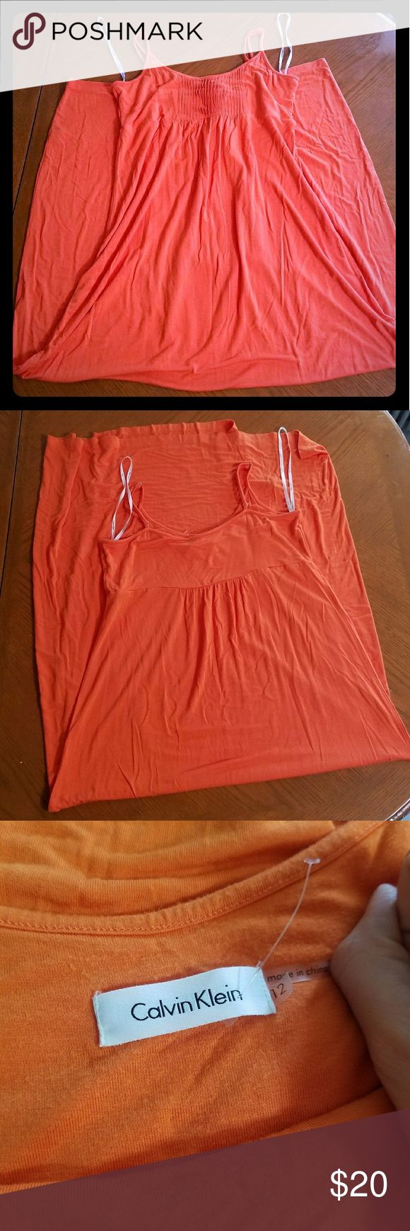 "Calvin Klein Orange Maxi Dress NWOT Great orange color. Spaghetti straps with length adjusters. Size 12. NWOT.  Waist (right under bust) to hem  approximately 44.5""  Waist approximately 16.5"" Pictures don't do this dress justice...it is truly beautiful. Calvin Klein Dresses Maxi"