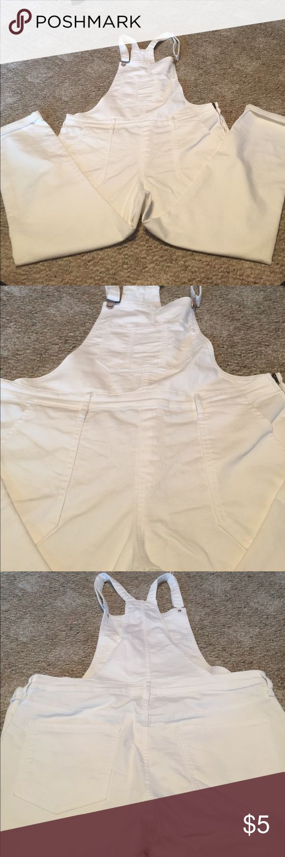 White Overalls Comfortable and stretchy white overalls from Old Navy. Has large pockets in front and back on pants, also large pocket on chest. The straps can be adjusted and there are belt loops! Old Navy Jeans Overalls