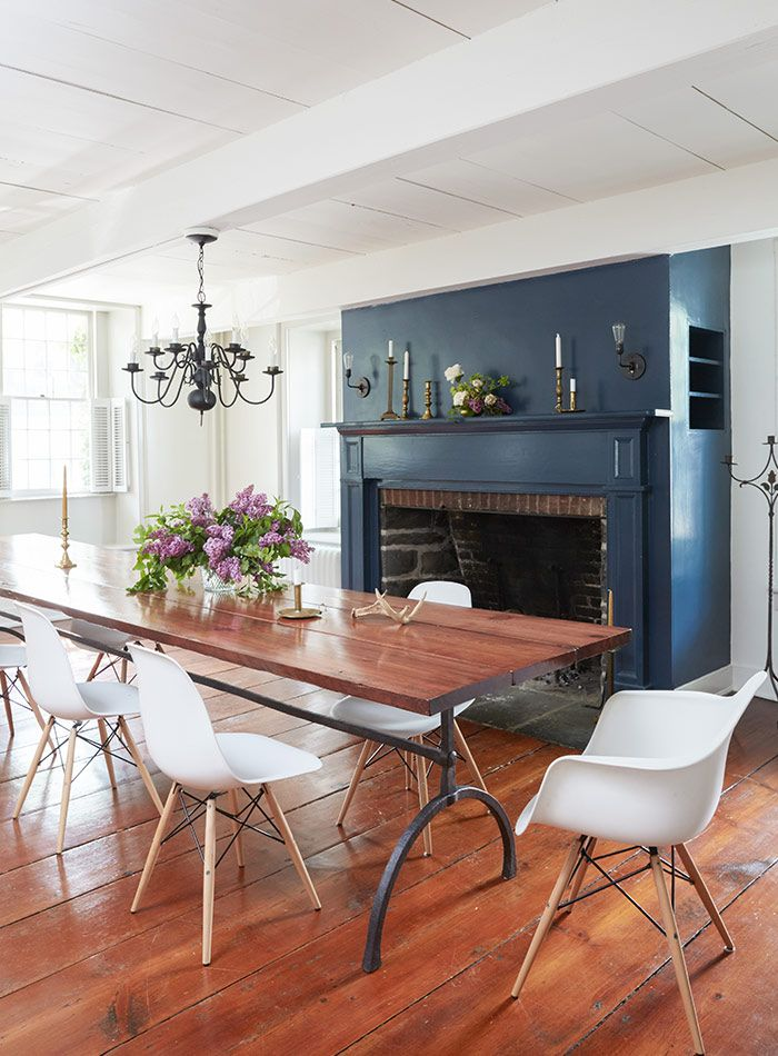 Dining Room With A Blue Fireplace And Wooden Floors In Charming Upstate New York Home