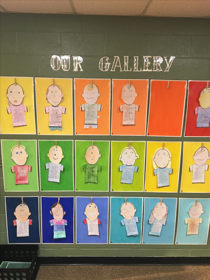 Paint chip theme classroom gallery wall. Display artwork with a clothespin hot glued to the top.
