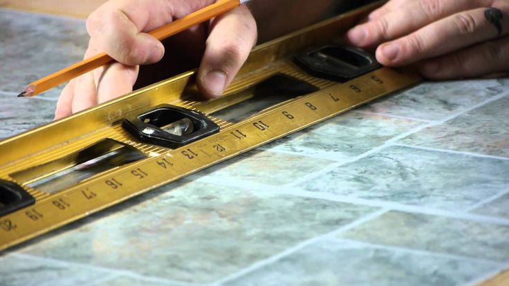 How to Install Self-Adhesive Floor Tiles on Top of Old Tiles : Working o...