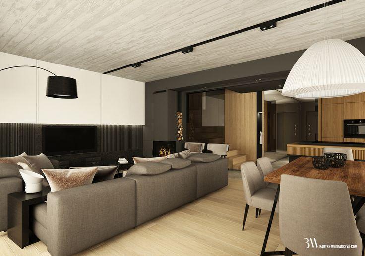 Jadalnia i salon z widokiem na ciemną kanapę Yang firmy Minotti i lampę Axo Bell nad drewnianym  stołem