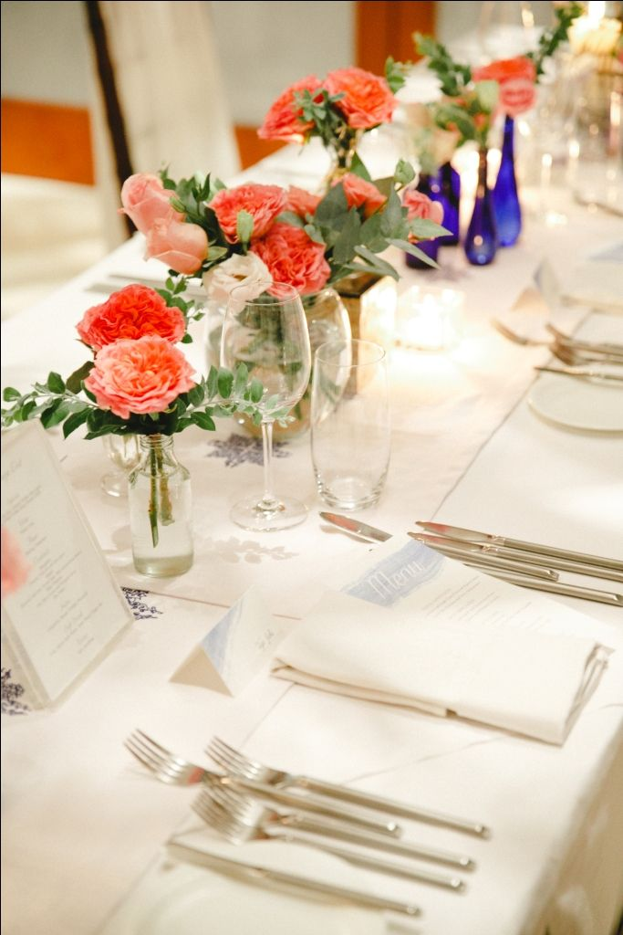 The table centerpiece in Coral David Austin, White Lisianthus, Eucalyptus and Pink Rose