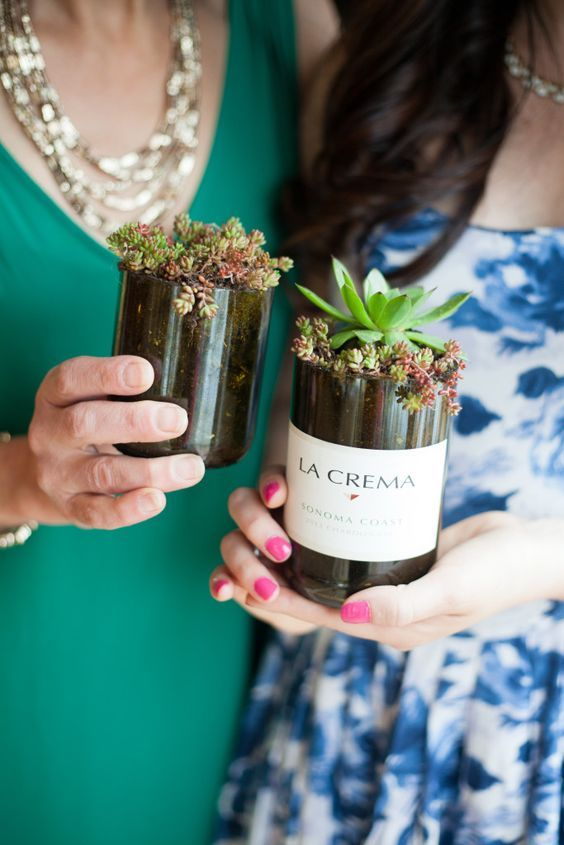 Some beautiful ideas for upcycling your empty wine bottles! These little succulent planters are so sweet.