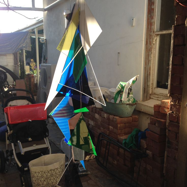 """60th decorations - hanging party location signifier piece.  Not in situ. Client had a blue/green geometric invite and said """"nothing cheesy, no balloons, no gold or silver."""""""