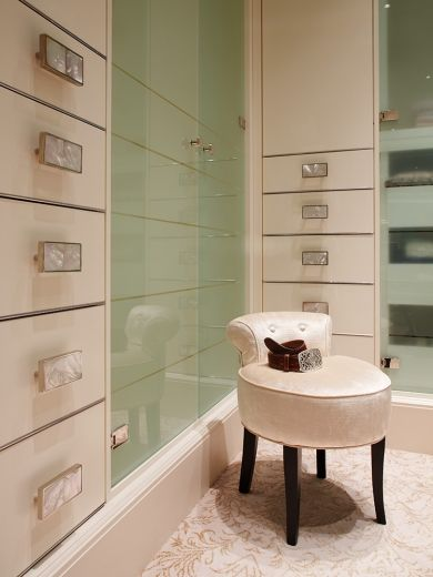 The luxurious mood of the Master Dressing Room is enhanced by han-made mother-of-pearl handles.