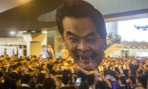 Pro-democracy protesters in Hong Kong hold up a giant cutout of Leung Chun-ying…