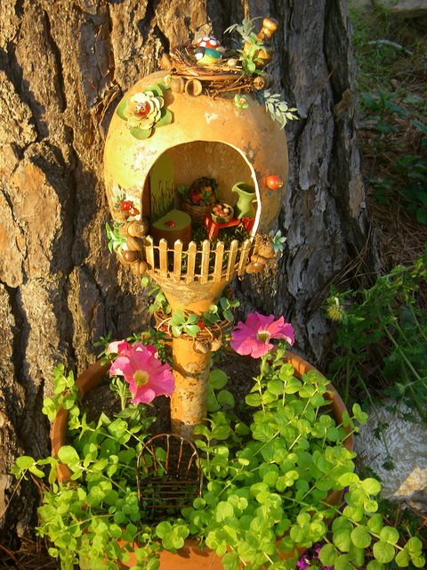 another fun fairy house idea....Like how the gourd was used upside down....cute....