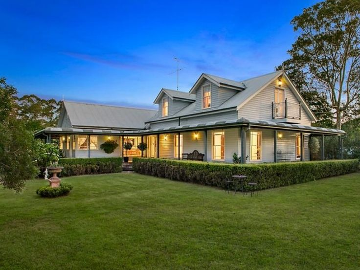 Country home with dormers and wrap around verndah with bullnose verandah roofing. Well landscaped grounds add to the country feel of this NSW property. #dural #sydney #australianhomes #landscaping