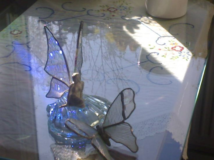 Fairy,  body is tinmade and wings are made by glass