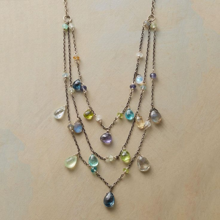"""THREEFALL NECKLACE -- Thoi Vo interprets the dance of a tropical waterfall in a handmade sterling silver and colorful gemstone necklace, with London topaz, peridot, apatite, aquamarine, labradorite, prehnite, moonstone, Oregon sunstone, citrine, iolite, chrysoprase, and green amethyst. Lobster clasp. Exclusive. Handmade in USA. 16"""" to 19""""L."""