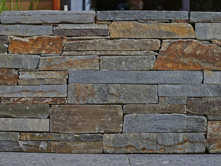 Close up of Eco Outdoor Baw Baw drystone walling with a flush finish. | Eco Outdoor | Baw Baw drystone walling | livelifeoutdoors | Stone Interiors | Natural stone walling | Garden design | Outdoor paving | Outdoor design inspiration | Outdoor style | Outdoor ideas | Luxury homes | Paving ideas | Garden ideas | Stone veneer | Stone walling | Stone wall cladding | feature wall