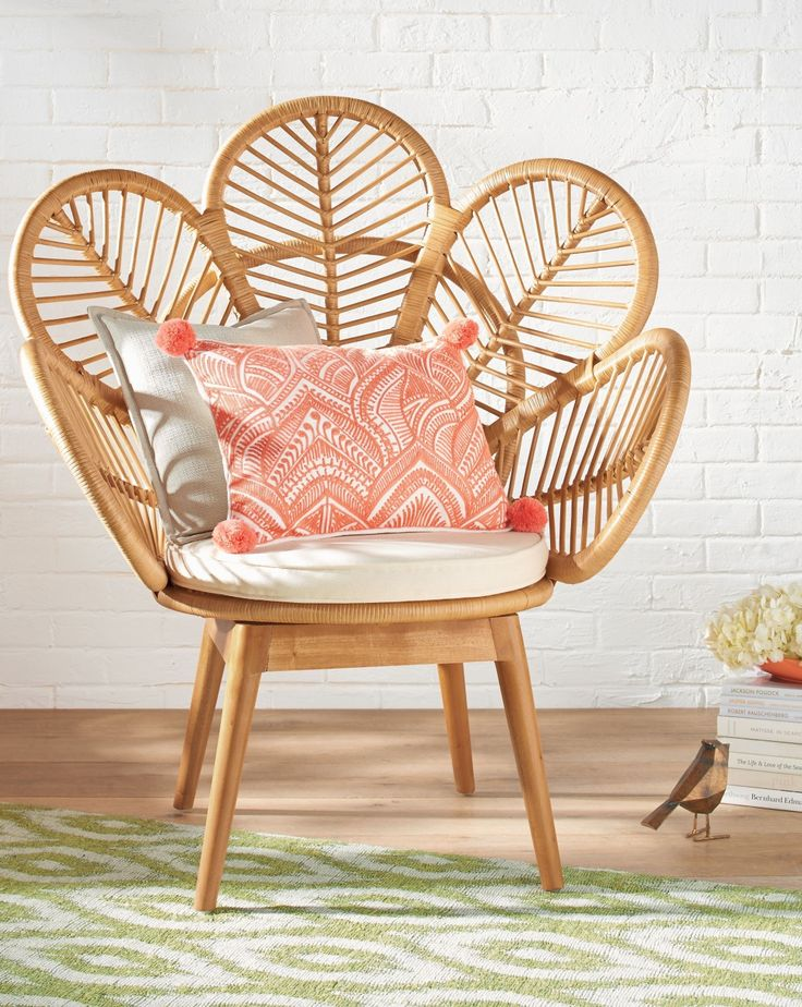 Our exclusive Daisie Rattan Chair is a playful yet sophisticated design that reminds you to bloom creatively wherever you're seated in life. This unique fan chair design features an open-style back that looks like the blossom of a flower. A little Boho, a little urban chic mixed together with comfortably lovely results.