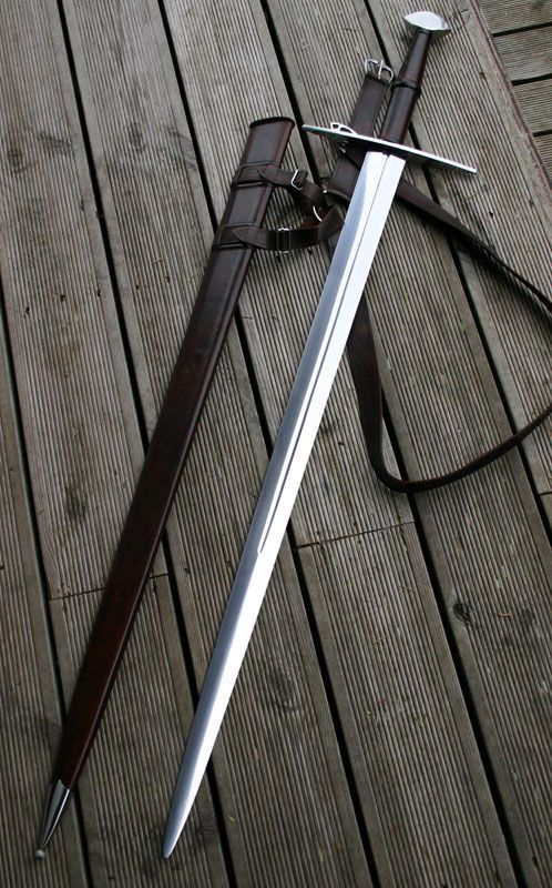 "Castle Keep - Large Two handed medieval Warsword, with brazil nut pommel and 38"" blade. Single narrow fuller, leather bound grip."