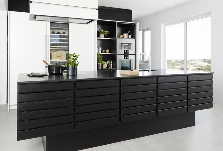 Form 1 // Black oak kitchen by Multiform