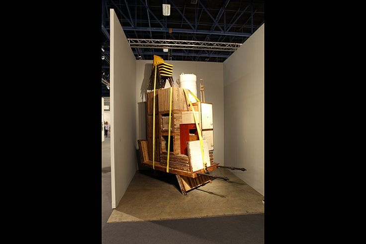 Theaster Gates; Migration Rickshaw for German Living; 2013. Wood, iron, tires, chairs, rope, plastic.