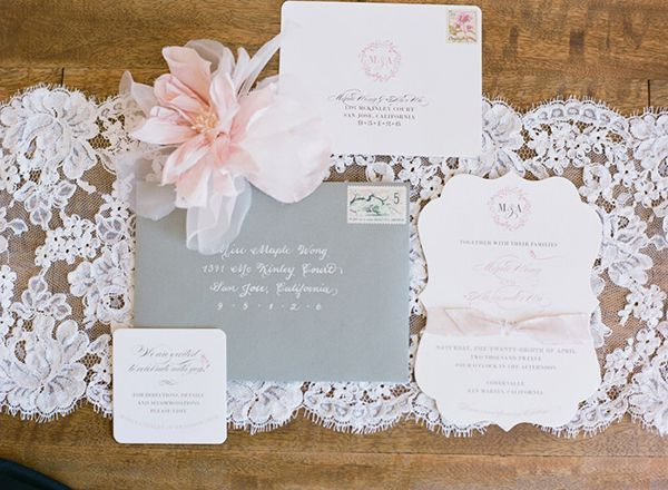 Die-cut bracket-shaped invitations from Foglio Press and gray envelopes with white calligraphy | Photo by Austin Warnock