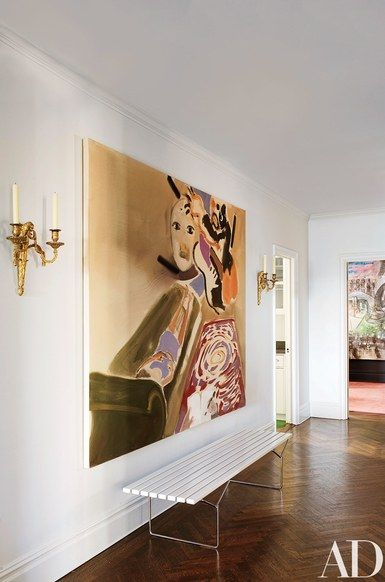 A painting by Sophie von Hellermann is displayed above a Harry Bertoia bench in the entrance hall | archdigest.com