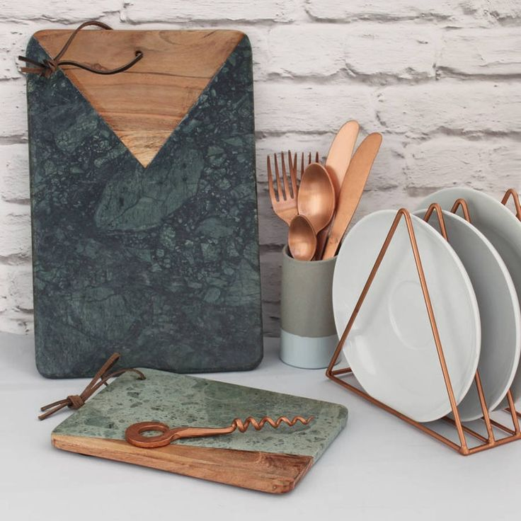 This stunning Marble And Wood Serving Board will add a touch of class to your kitchen essentials. Made from acacia wood and beautiful grey/green marble, this board makes a perfect serving or chopping board to prepare and display your favourite foods, treats and snacks at the dining table. Each board is finished with a lovely leather string, so you can hang it up whilst not in use. Perfect for presenting party nibbles, canapes or making up a cheese board! Two sizes are available, a small ...