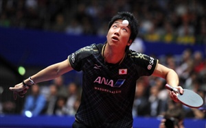 Japan's Jun Mizutani returns a ball to Dimitrij Ovtcharov of Germany on March 31, 2012 in Dortmund, western Germany, during the men's semi final of the World Team Table Tennis Championships 2012. Ovtcharov won the match 0-3.