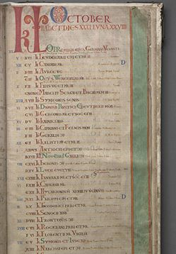 Codex Gigas. At the top of the page is a large KL (for Kalendae), followed by the name of the month, October (f. 310r). The vertical green stripe with red borders in the outer margin is purely decorative.