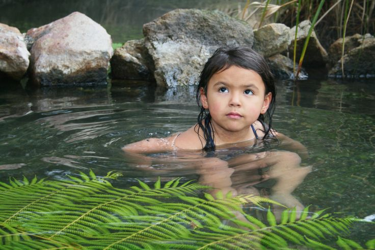 Just as her ancestors have done, our young moko(grandchild) is enjoying the geothermal pool. Photo taken by David Walmsley. (Granddad)