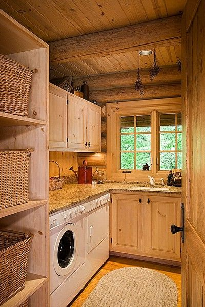 rustic but functional - love the layout, and storsge baskets, and folding area, and window. I would paint ceiling and floors white, put up a colorful curtain, maybe add a pretty chandelier, apron sink.