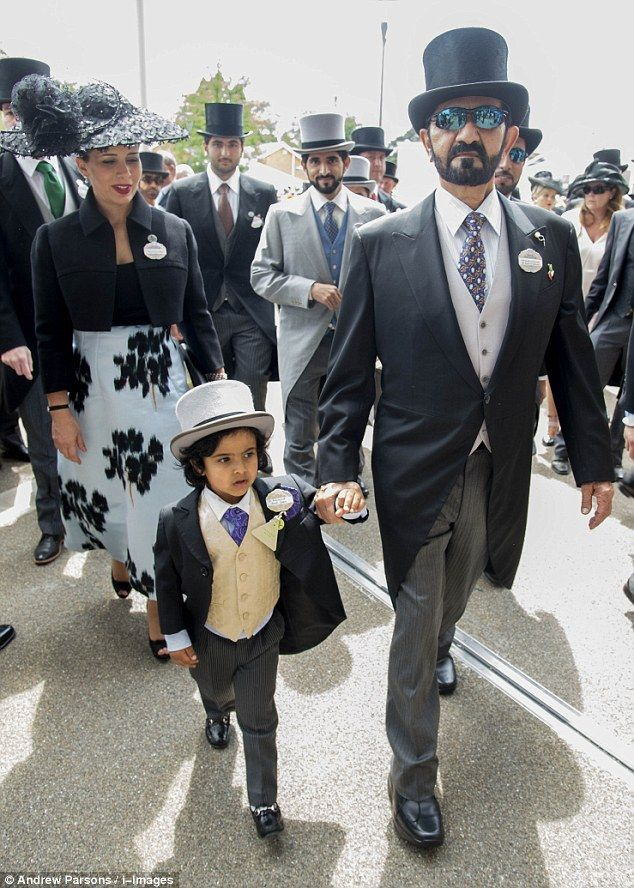 Adorable: Little Mohammed makes his way through the crowd, watched by Princess Haya of Jor...
