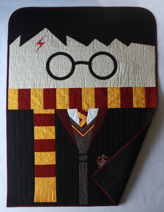 This listing includes:  *36x48 Harry Potter patchwork and applique baby quilt with embroidered Gryffindor crest, and 3D toggles and tassels for an