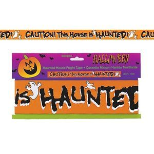 """Haunted House Caution Party Tape.  Welcome your guests to your spooky Halloween Party with this scary party tape! This 6m long decoration says """"Caution! This house is haunted!"""" Section off the festivities with this caution tape banner. Decorate your party room, doorways, windows and walls or table edges with this fun party prop.  7.6cm x 6m; plastic."""