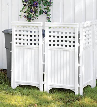 Camouflaging An Eyesore garbage can cover, looks like bead board, lattice and edging, the hinges have rods that could be moveable, to pin it into the ground so it doesn't blow over. DIY