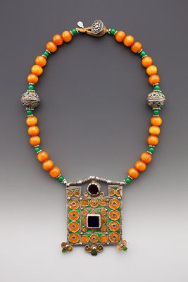 by Tamara Hill | Rare antique Moroccan Jewish woman's amulet pendant ('Herz'), green & yellow enamel, inset red glass gems; on single strand of resin amber 10 mm. rosary & 5 mm. green glass trade beads, 18 mm. rare enameled silver Moroccan beads, Balinese silver spacers, tubular silver beads & silver hand crafted button.