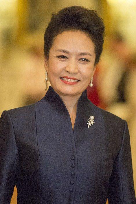 Madame Peng dressed in navy