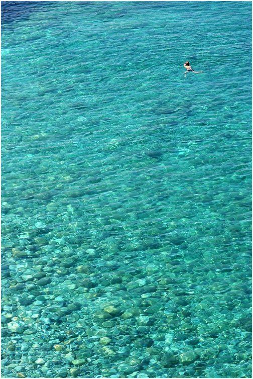 Swimming in Mylopotamos beach, Magnesia prefecture (Pelion mountain)