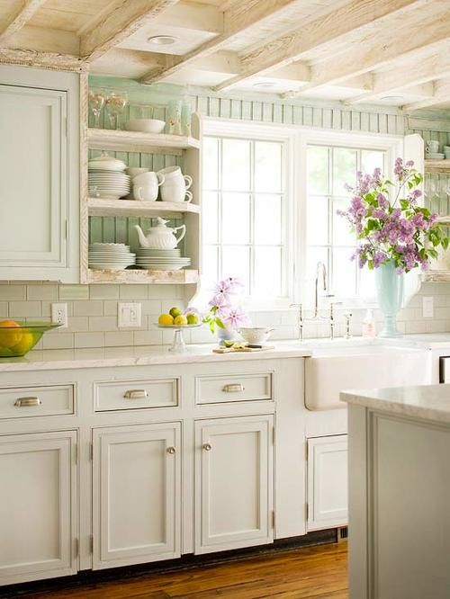 White on white kitchen, pale green beadboard, drawer cup pulls, cabinet knobs, white subway backsplash, neutral island