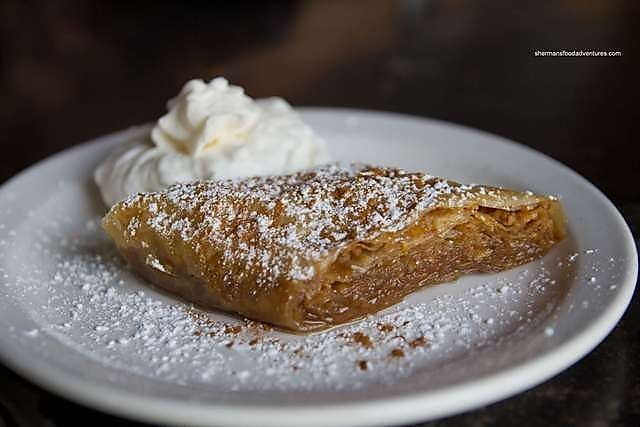 A delicately prepared greek dessert. Layers of phyllo pastry, cinnamon, honey & nuts are combined to create the perfect piece of baclava