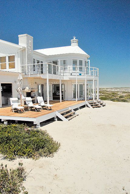 Beach house - just wish there was an awning or something to wield against direct sun. Sigh.
