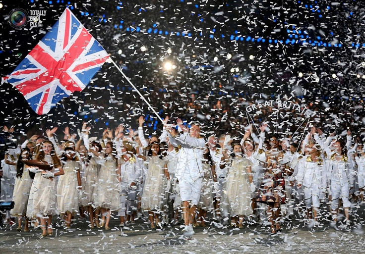 53 Britain's flag bearer Chris Hoy holds the national flag during the opening ceremony of the London 2012 Olympic Games. POOL/REUTERS