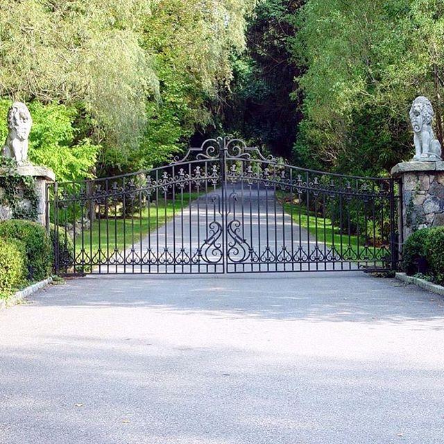 32 best posts pillars statues images on pinterest cobblestone custom wrought iron driveway gate design with stately lion statues on stone pillars our solutioingenieria Images