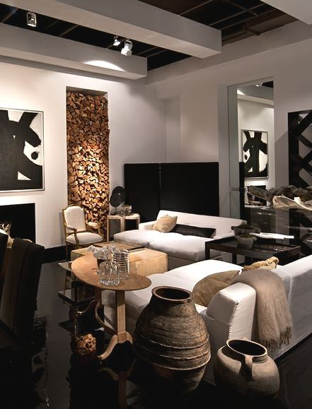 This is a very beautiful room, the simple white sofas let the art stand  out.sherri bostwick African accents Home Hagereseb African Home African  Decor