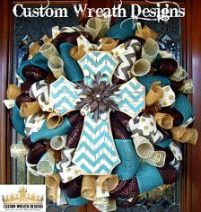 This is a dark brown wreath trimmed in chevron burlap and blue burlap ribbon and has a cream with gold dot ribbon and a cream mesh and burlap. This also has a beautiful wood Chevron cross in the middle with blue curly picks. This style looks great all year round and this measures around 28 and this is very full and durable.