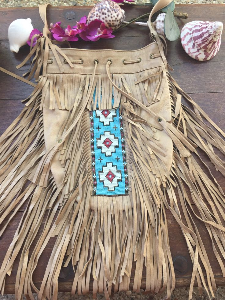 A personal favourite from my Etsy shop https://www.etsy.com/au/listing/481472328/bohemian-hand-beaded-fringe-bag