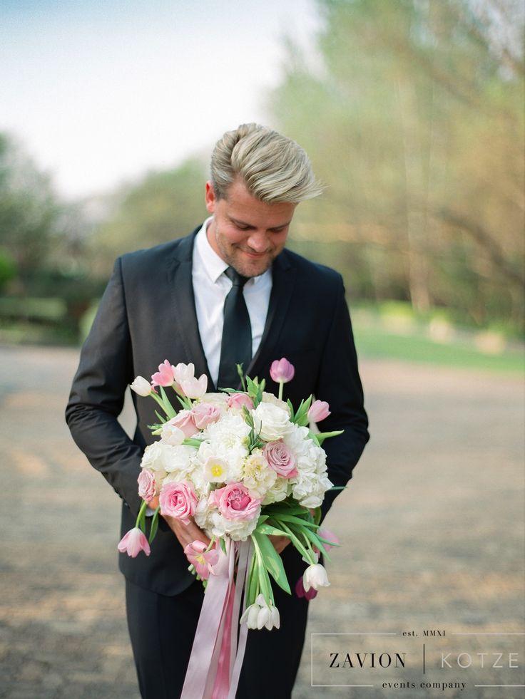 Our Zavion holding the brides Bouquet :)