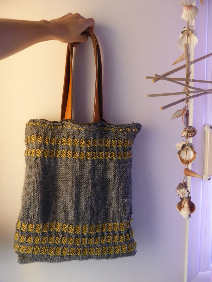 self knitted and sewn bag with leather straps