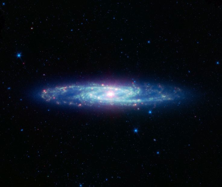 Also known as NGC 253, the Sculptor galaxy is part of a cluster of galaxies visible to observers in the Southern hemisphere. It is known as a starburst galaxy for the extraordinarily strong star formation in its nucleus. - Image: NASA/JPL-Caltech