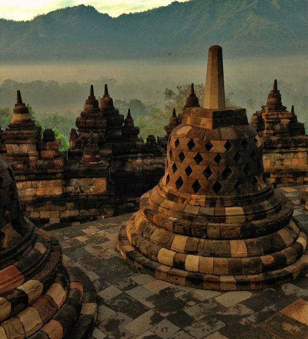 Borobudur Temple - Magelang Jawa Tengah, Borobudur, Indonesia — by Jesus IV Villamor. Borobudur temple complex in Central Java, Indonesia dating from the 8th century, and a UNESCO World Heritage Site.